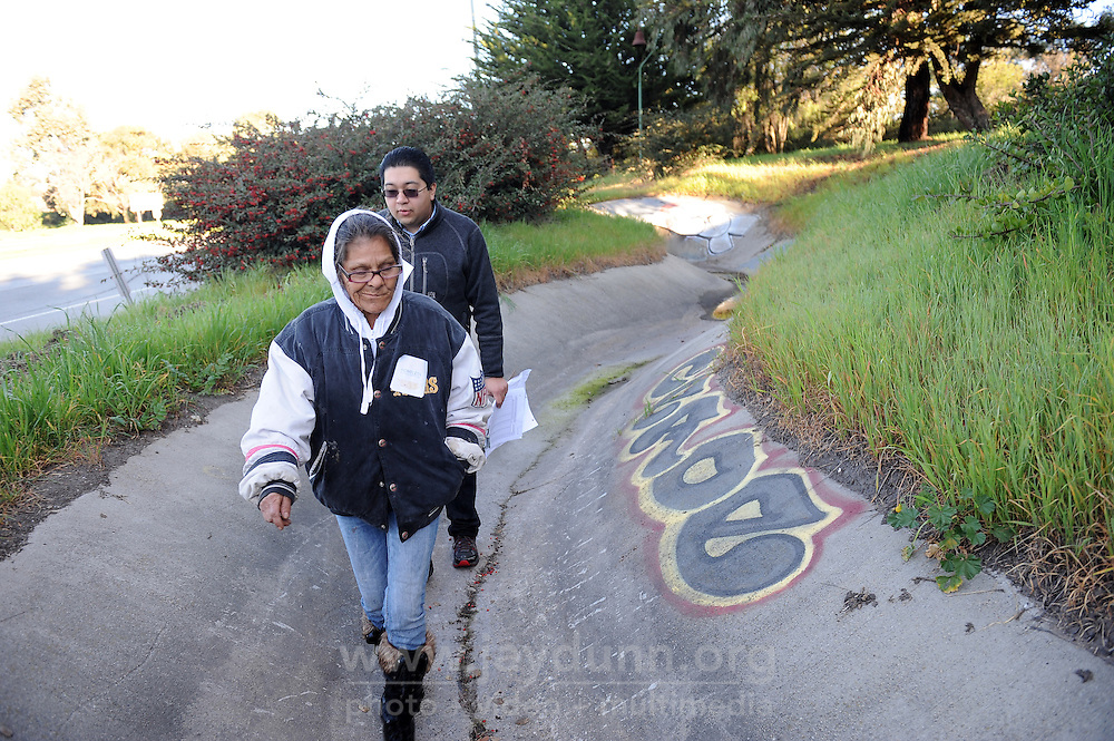 Guide Diana Soto and volunteer Javier Celedon walk the drainage areas close to Hwy 101 and W. Laurel Avenue in Salinas during Wednesday's homeless census.