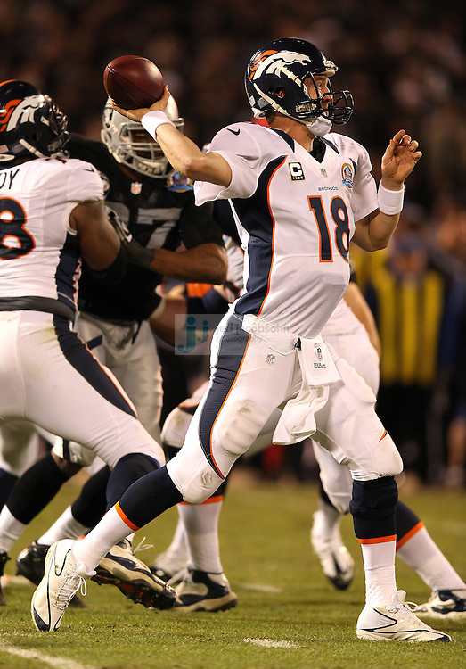 Denver Broncos quarterback Peyton Manning (18) in action against  the Oakland Raiders during an NFL game on Sunday, December 6, 2012 at the Oakland Coliseum in Oakland, Ca.  (photo by Jed Jacobsohn)