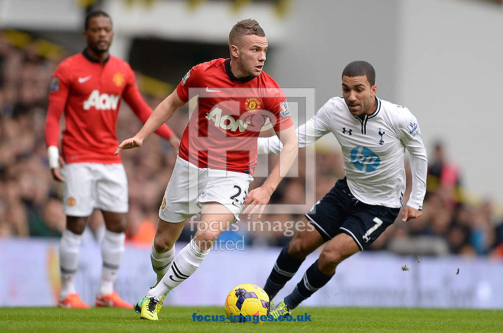 Picture by Andrew Timms/Focus Images Ltd +44 7917 236526<br /> 01/12/2013<br /> Aaron Lennon of Tottenham Hotspur and Tom Cleverley of Manchester United during the Barclays Premier League match at White Hart Lane, London.