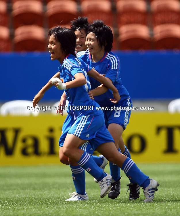 Japan celebrate a goal.<br />