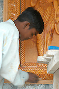 India, Manali, Kullu District, Himachal Pradesh, Northern India. carpenter at work engraving a wooden image in a temple