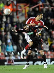 Bristol City's Liam Fontaine in ariel action with Middlesborough's  Scott McDonald. Photo mandatory by-line: Neil Phillips/ JMPUK - 03/12/2011- SPORT - Bristol City v Middlesbrough - Ashton Gate - Bristol - England