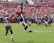 TAMPA, FL - OCTOBER 15:  Cornerback Deltha O'Neal #24 of the Cincinnati Bengals goes airborne to break up a pass intended for wide receiver Michael Clayton #80 of the Tampa Bay Buccaneers at Raymond James Stadium on October 15, 2006 in Tampa, Florida. The Bucs defeated the Bengals 14-13. (©Paul Anthony Spinelli) *** Local Caption *** Deltha O'Neal;Michael Clayton