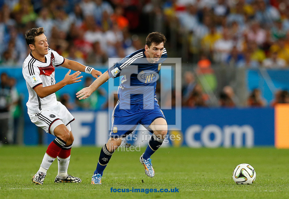 Germany's Mesut Ozil and Argentina's Lionel Messi during the 2014 FIFA World Cup Final match at Maracana Stadium, Rio de Janeiro<br /> Picture by Andrew Tobin/Focus Images Ltd +44 7710 761829<br /> 13/07/2014