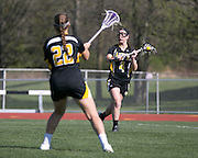 Emma Clark passes to a teammate during a game at Rush-Henrietta High School on Thursday, May 7, 2015.