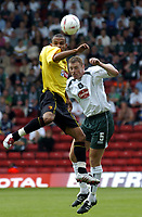 Fotball<br /> Foto: SBI/Digitalsport<br /> NORWAY ONLY<br /> <br /> Watford v Plymouth Argyle<br /> Coca-Cola Championship. 28/08/2004.<br /> <br /> Danny Webber gets above Graham Coughlan to win the ball.