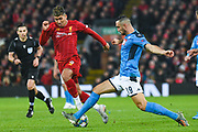 Liverpool forward Roberto Firmino (9) and Napoli defender Nikola Maksimovic (19) in action during the Champions League match between Liverpool and Napoli at Anfield, Liverpool, England on 27 November 2019.