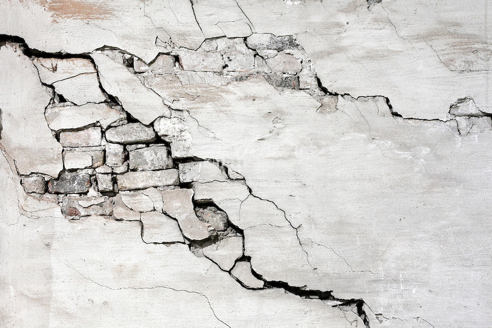 old brick wall with large crack