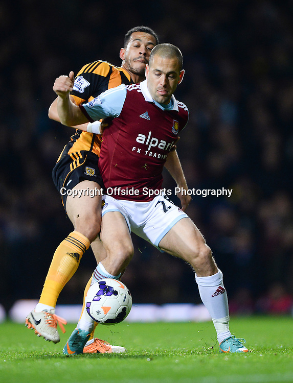 26 March 2014 - Barclays Premier League - West Ham United v Hull City - Joe Cole of West Ham United tangles with Curtis Davis of Hull City - Photo: Marc Atkins / Offside.