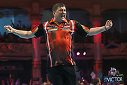 Mensur Suljovic wins the match and celebrates during the BetVictor World Matchplay Darts 2018 semi final at Winter Gardens, Blackpool, United Kingdom on 28 July 2018. Picture by Shane Healey.