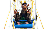 A costumed festival goer rides the Ferris Wheel at The Nateva Music and Camping Festival in Oxford, Maine over the 4th of July Weekend 2010.