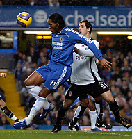 Photo: Ed Godden.<br />Chelsea v Fulham. The Barclays Premiership. 30/12/2006.<br />Chelsea's Didier Drogba (L), is challenged by Carlos Bocanegra.