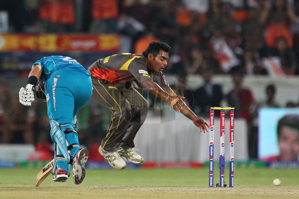 Ashish Reddy tries to run out Ross Taylor during match 3 of of the Pepsi Indian Premier League between The Sunrisers Hyderabad and The Pune Warriors held at the Rajiv Gandhi International  Stadium, Hyderabad  on the 5th April 2013..Photo by Ron Gaunt-IPL-SPORTZPICS..Use of this image is subject to the terms and conditions as outlined by the BCCI. These terms can be found by following this link:..http://www.sportzpics.co.za/image/I0000SoRagM2cIEc
