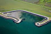 Nederland, Zeeland, Schouwen, 12-06-2009; Oosterschelde, vluchthaven ter hoogte van Flaauwers Inlaat. Direkt achter de zeedijk ligt een tweede (reserve) dijk, het tussengelegen gebeid is een inlaag. In het kader van plan Tureluur is deze inlaag gedeeltelijk onder water gezet om zo een brakzout moerasgebied te maken. Deze nieuwe natuur  moet het afname van de schorren en het intergetijdengebied - door de aanleg van de stormvloedkering - compenseren.Swart collectie, luchtfoto (25 procent toeslag); Swart Collection, aerial photo (additional fee required).foto Siebe Swart / photo Siebe Swart