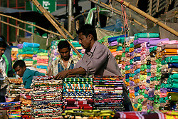 BANGLADESH DHAKA KAWRAN BAZAAR 2MARB05 - Cloth stall at Kawran Bazaar vegetable market. The Bazaar has been in the Tejgaon area for at least 30 years and is one of the largest markets in Dhaka city...jre/Photo by Jiri Rezac..© Jiri Rezac 2005..Contact: +44 (0) 7050 110 417.Mobile:  +44 (0) 7801 337 683.Office:  +44 (0) 20 8968 9635..Email:   jiri@jirirezac.com.Web:    www.jirirezac.com..© All images Jiri Rezac 2005- All rights reserved.