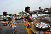 A group of Beninese women sell fish along the lagoon of Ganvie in Cotonou, Benin March 1, 2008.