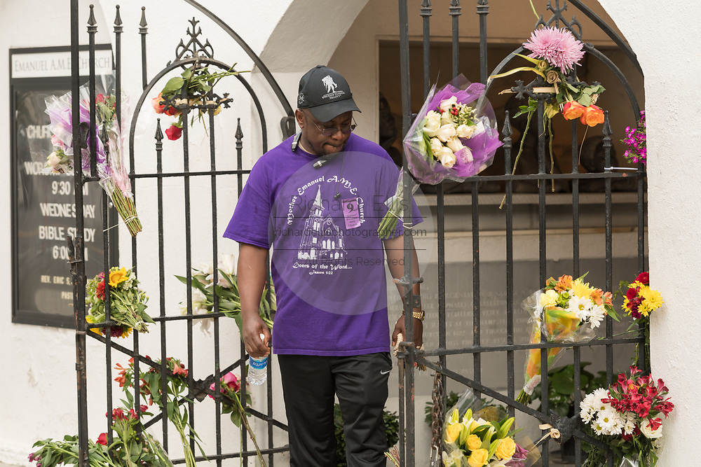 A family of the Charleston 9 views floral tributes left at the Mother Emanuel African Methodist Episcopal Church on the 2nd anniversary of the mass shooting June 17, 2017 in Charleston, South Carolina. Nine members of the historic African-American church were gunned down by a white supremacist during bible study on June 17, 2015.