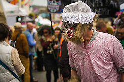 A man wearing a wolfs head mask in the Mazey Day celebrations in Penzance, Cornwall.