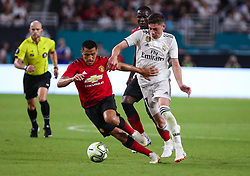 July 31, 2018 - Miami Gardens, Florida, USA - Manchester United F.C. forward Alexis Sanchez (7) (left) steels the ball from Real Madrid C.F. midfielder Federico Valverde (37) (right) during an International Champions Cup match between Real Madrid C.F. and Manchester United F.C. at the Hard Rock Stadium in Miami Gardens, Florida. Manchester United F.C. won the game 2-1. (Credit Image: © Mario Houben via ZUMA Wire)