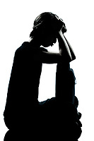 one caucasian young teenager silhouette boy or girl pouting sadness  full length in studio cut out isolated on white background