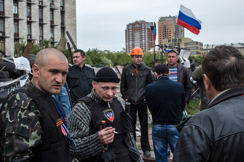 DONETSK, UKRAINE - MAY 8: Pro-Russian activists stand guard outside the occupied regional administration headquarters on May 8, 2014 in Donetsk, Ukraine. Tensions in Eastern Ukraine are high after pro-Russian activists seized control of at least ten cities and ahead of the Victory Day holiday and a planned referendum on greater autonomy for the region. (Photo by Brendan Hoffman/Getty Images) *** Local Caption ***