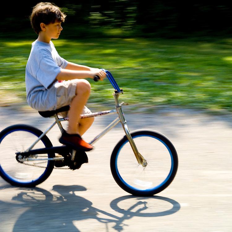 Boy riding bicycle, mechanical energy, kinetic energy