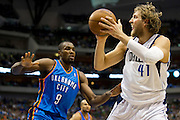 Dirk Nowitzki (41) of the Dallas Mavericks shoots the ball over Serge Ibaka (9) of the Oklahoma City Thunder at the American Airlines Center in Dallas on Sunday, March 17, 2013. (Cooper Neill/The Dallas Morning News)