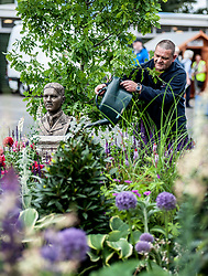 To mark it's centenary, the Commonwealth War Graves Commision has teamed up with Glen Art and the Wilfred Owen Association to create a remembrance garden at the annual Gardening Scotland event. Pictured is volunteer and forces veteran Jason Turner from Edinburgh keeping the plants well watered beside a bust of the WW1 poet Wilfred Owen.<br /> © Dave Johnston/ EEm