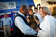 Republican presidential candidate Herman Cain greets a supporter at the Dickinson County GOP Summer Picnic in Okoboji, Iowa, August 10, 2011.