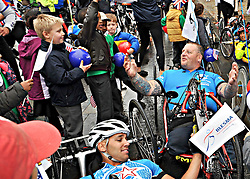 © Licensed to London News Pictures. 11/10/2012. Steve Gill 43 formally from the 2nd  Battalion Royal Anglian Regiment.  30 British and American wounded soldiers and veterans are welcomed by school children from St Alfege with St Peters School Greenwich. after riding into London, today 11 October 2012, after completing 'Soldier Ride'  The 30 serving and formers soldiers, all with life-changing injuries sustained in the line of duty, departed from Sandringham Estate, waved off by His Royal Highness the Duke of Edinburgh last Saturday. They travelled the Norfolk, Suffolk and Essex coast calling at Cromer, Great Yarmouth, Ipswich, Colchester, Southend-on-Sea, Rainham all the way to the finish line in Greenwich, London.  Riders used modified bikes, hand cycles and standard road bikes, depending on their needs. Photo credit : Rob Leyland/LNP