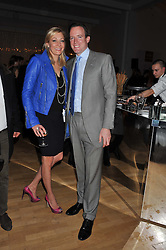 NADJA SWAROVSKI and her husband RUPERT ADAMS at the Whitechapel Gallery Art Plus Opera gala in association with Swarovski held at the Whitechapel Gallery, London on 15th March 2012.