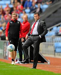 Bristol City manager, Steve Cotterill kicks the ball back  - Photo mandatory by-line: Joe Meredith/JMP - Mobile: 07966 386802 - 18/10/2014 - SPORT - Football - Coventry - Ricoh Arena - Bristol City v Coventry City - Sky Bet League One