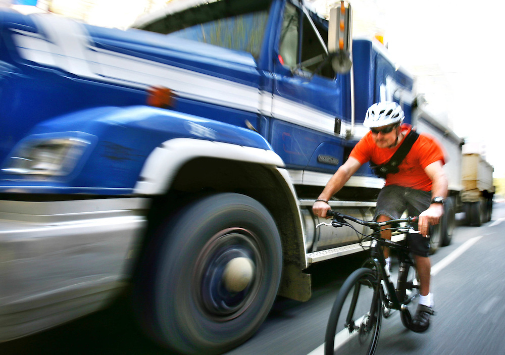 Cyclist Adam Banden in Melbourne CBD. New research has been realeased into the dangers of cycling in traffic  Pic By Craig Sillitoe SPECIALX 000 melbourne photographers, commercial photographers, industrial photographers, corporate photographer, architectural photographers, This photograph can be used for non commercial uses with attribution. Credit: Craig Sillitoe Photography / http://www.csillitoe.com<br />
