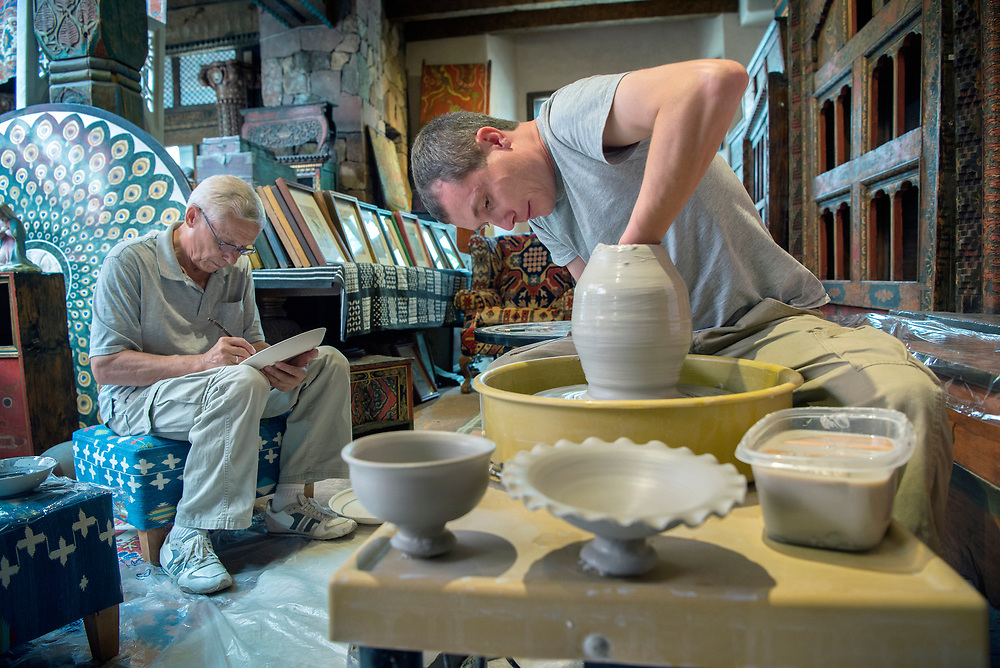em071317l/jnorth/Rustam Usmanov, left, and his son Damir Usmanov, from Uzbekistan, demonstrate their ceramic art at Seret and Son in Santa Fe Thursday July 13, 2017. They were two of several artist that are here for the International Folk Art Market and were demonstrating their crafts at businesses around town.  (Eddie Moore/Albuquerque Journal)