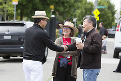 June 17, 2017 - Seattle, Washington, United States - Seattle, Washington: State Senator and mayoral candidate BOB HASEGAWA greets a visitor at the Beacon Hill Block Party.  In the center is Betty Jean Williamson with Beacon Arts, an all volunteer nonprofit organization dedicated to providing opportunities for artists and audiences in the neighborhood. The senator, a longtime labor and social justice activist from the Beacon Hill neighborhood, has represented the 11th Legislative District since January 2013. (Credit Image: © Paul Gordon via ZUMA Wire)