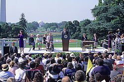 United States President George H. W. Bush signs the Americans with Disabilities Act of 1990 into law during a ceremony on the South Lawn of the White House in Washington, D.C. on July 26, 1990. Pictured, on stage, (left to right): unidentified interpreter, Reverend Harold Wilke, first lady Barbara Bush, U.S. Vice President Dan Quayle, Evan Kemp, President Bush, Justin Dart, Sandra Parrino, and unidentified interpreter. The act prohibited employer discrimination on the basis of disability. Credit: Ron Sachs / CNP /ABACAPRESS.COM