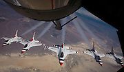 U.S. Air Force Thunderbirds near the Sierra Nevada mountain range. there were refueled by a KC-135 Stratotanker and crew from the 940th Air Refueling Wing, Beale Air Force Base, Ca. The Thunderbird's mission is to perform precision  aerial maneuvers demonstrating the capabilities of Air Force high performance aircraft to people throughout the world. the mission of the KC-135 tanker is to extend the range or flight time of other aircraft there by enhancing the global reach and power of the U.S. Air Force. (Photo/Lance Cheung) ..PHOTO COPYRIGHT 2007 LANCE CHEUNG.This photograph is NOT within the public domain..This photograph is not to be downloaded, stored, manipulated, printed or distributed with out the written permission from the photographer. .This photograph is protected under domestic and international laws.