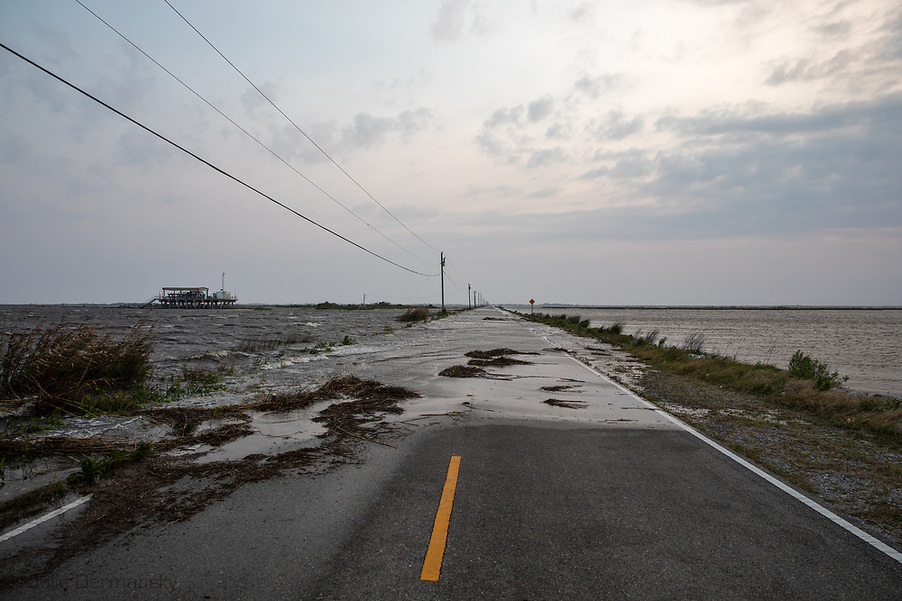 Water passing over Island Road, the only road to Isle de Jean Charles, in Terrebonne Parish, Louisiana  on April 13, 2019. The road is often flooded when the wind is from the South as it was on April 13.