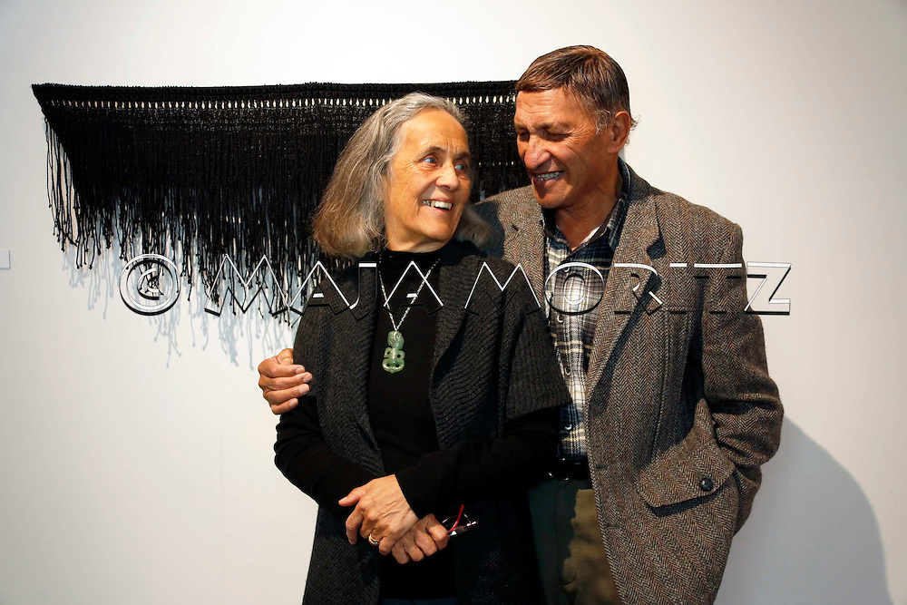 Patricia Grace and her husband Waiariki Grace in front of art work created by their daughter Kohai Grace, Pataka Museum of Arts and Cultures, Porirua, New Zealand