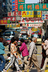 Pedestrians crossing a busy street in Kowloon district of Hong Kong China