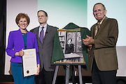 Ohio University's Interim President, David Descutner, center, and 2013 Distinguished Professor recipient, Dr. Tom Carpenter, right, unveil the 2017 Distinguished Professor portrait of Dr. Judith Yaross Lee at Ohio University's Baker Center Ballroom on Monday, February 20, 2017.