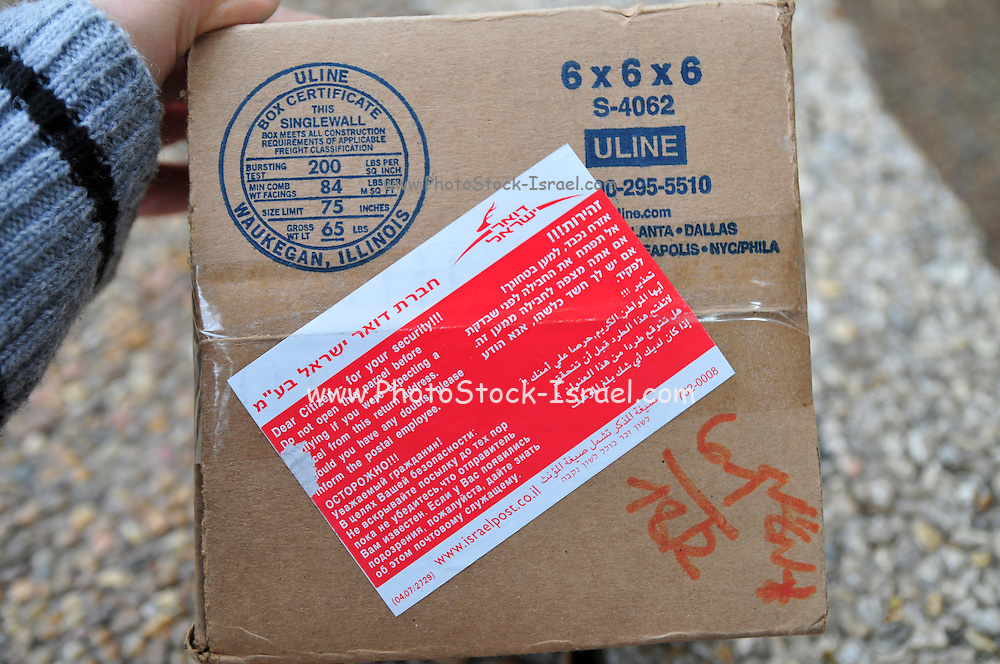 Postal bomb scare - a warning on a postal package warning against receiving packages from unknown sources Red warning in Hebrew, Arabic, English and Russian