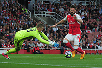 Football - 2016 / 2017 Premier League - Arsenal vs. Sunderland<br /> <br /> Olivier Giroud of Arsenal is foiled by Jordan Pickford at The Emirates.<br /> <br /> COLORSPORT/ANDREW COWIE
