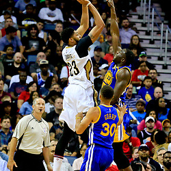Oct 28, 2016; New Orleans, LA, USA;  New Orleans Pelicans forward Anthony Davis (23) shoots over Golden State Warriors forward Draymond Green (23) during the first quarter of a game at the Smoothie King Center. Mandatory Credit: Derick E. Hingle-USA TODAY Sports