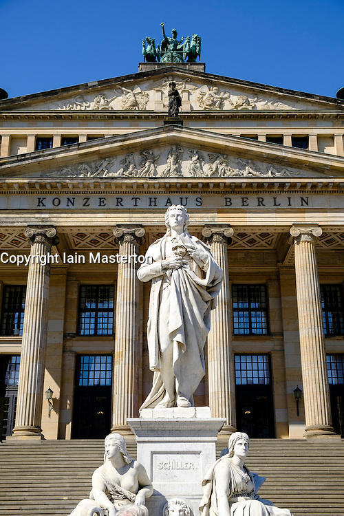 Schiller statue and Kozerthaus in Gendarmenmarkt square in Mitte Berlin Germany