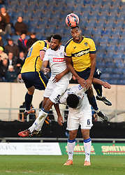 Oxford United's Tyrone Barnett wins a header - Photo mandatory by-line: Paul Knight/JMP - Mobile: 07966 386802 - 06/12/2014 - SPORT - Football - Oxford - Kassam Stadium - Oxford United v Tranmere Rovers - FA Cup Second Round