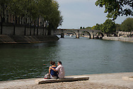 France. Paris. 4th district. Seine river quay des Celestins.  . people sunbathing   on right bank quays.   / bain de soleil sur le quai des Celestins
