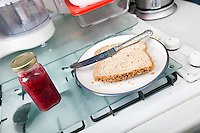 Baked bread and jam bottle on kitchen counter