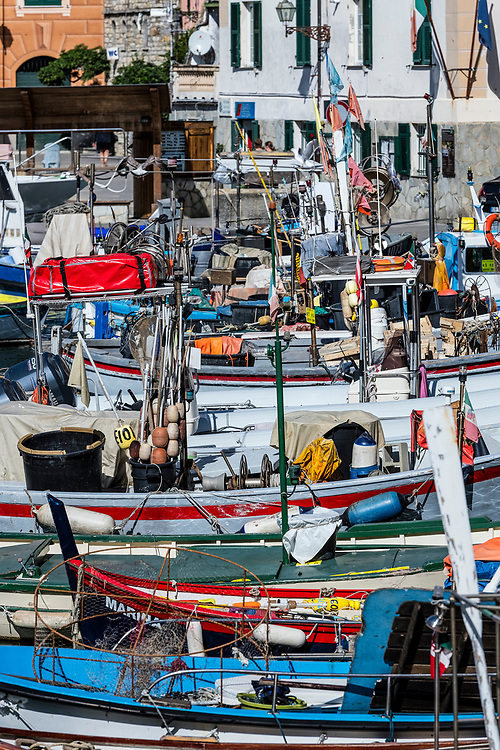 Rustic, fishing boats docked in harbor, Camogli, Liguria, Italy.