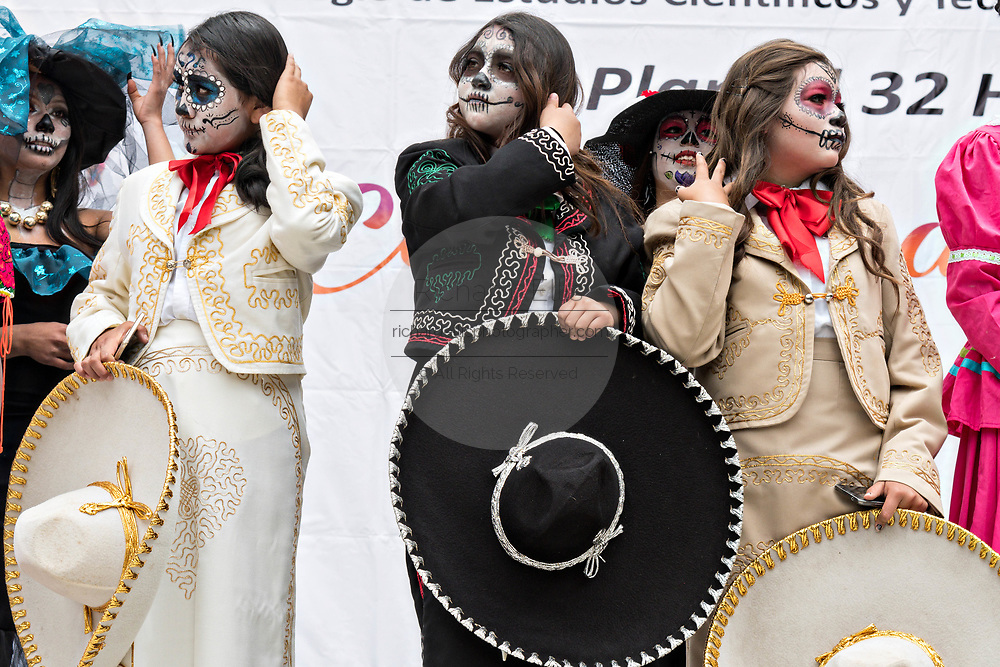 Young women dressed in La Calavera Catrina costumes during the Day of the Dead or Día de Muertos festival October 31, 2017 in Patzcuaro, Michoacan, Mexico. The festival has been celebrated since the Aztec empire celebrates ancestors and deceased loved ones.